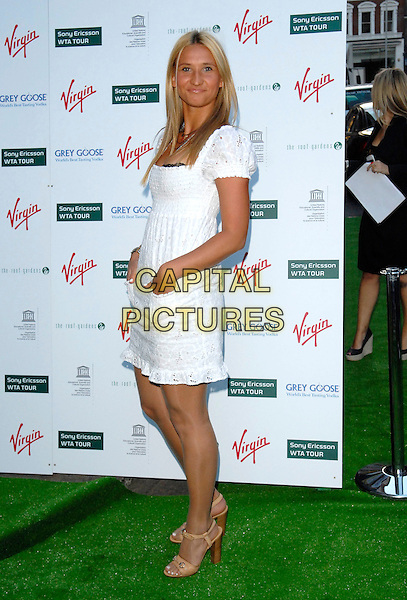 TATIANA GOLOVIN.Sony Ericsson WTA Tour Pre-Wimbledon Party, The Roof Gardens, Kensington, London, England..June 21st, 2007.full length white broderie anglaise dress hands in pockets.CAP/FIN.©Steve Finn/Capital Pictures