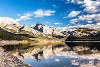 Sprey Lake capturing the reflection of the Kananaskis Mountain Rang on its calm waters