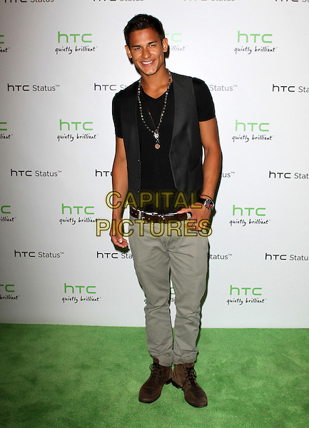 Bronson Pelletier.The HTC Statusª Social Launch Event held at Paramount Studios in Hollywood, California, USA..July 19th, 2011.full length black top waistcoat grey gray jeans denim.CAP/ADM/KB.©Kevan Brooks/AdMedia/Capital Pictures.