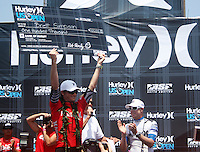 American and Huntington Beach local Brett Simpson holds his check high as he captures the crown and $100,000.00 first place prize. 2009 WQS 6 Star US Open of Surfing in Huntington Beach, California on Sunday July 26, 2009. ..