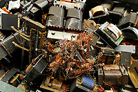 GERMANY, Hamburg, recycling of electronical scrap and old consumer goods at company TCMG, the trash is collected by the urban waste disposal system and than processed and separated here after metals like copper and plastics for further recycling and reuse, by law is not allowed to export e-scrap to africa and other countries, transformer with copper cable