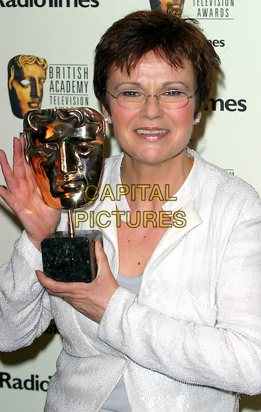 JULIE WALTERS.BAFTA TV Awards, Grosvenor House Hotel, London, .18th April 2004..portrait headshot trophy.Ref: BR.www.capitalpictures.com.sales@capitalpictures.com.©Capital Pictures.