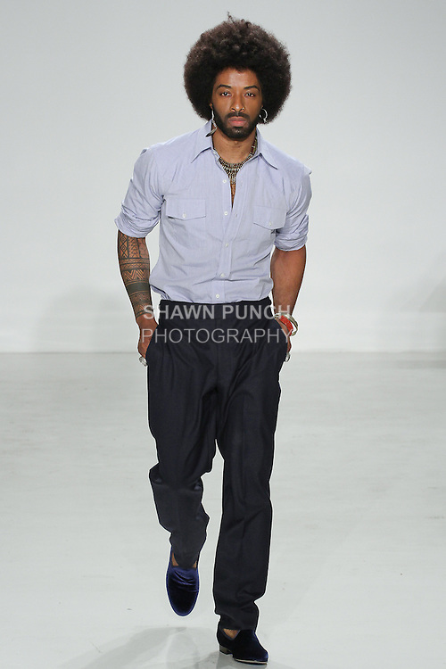 Model walks runway in a western BD and button tab navy trouser from the Palmiers du Mal Spring Summer 2017 collection by Brandon Capps and Shane Fonner, at Skylight Clarkson Square on July 14 2016, during New York Fashion Week Men's Spring Summer 2017.