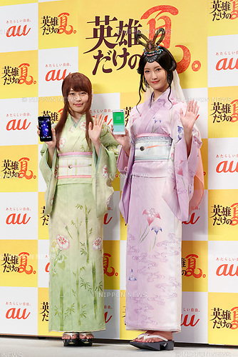 (L to R) Japanese actresses Kasumi Arimura and Nanao wearing traditional Japanese kimono pose for cameras during a press conference for the new mobile devices of AU's 2017 Summer Selection on May 30, 2017, Tokyo, Japan. Takashi Tanaka, President of AU's parent KDDI Corporation introduced nine new smartphones, including ones that make use of Google Assistant, and also a new ''au HOME'' service which allows customers to control home electronics through their devices. (Photo by Rodrigo Reyes Marin/AFLO)