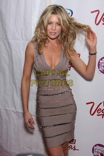 ABBEY CLANCY (ABIGAIL CLANCY).Attending the 2010 Sports Illustrated Swimsuit Issue Launch Party at Provocateur,  New York, NY, USA, February 9th, 2010..half 3/4 length hand touching hair Herve Leger body con sleeveless abby clancey cleavage beige greige grey gray beaded bandage dress crystals jewelled                                                                           CAP/LNC/TOM.©LNC/Capital Pictures .