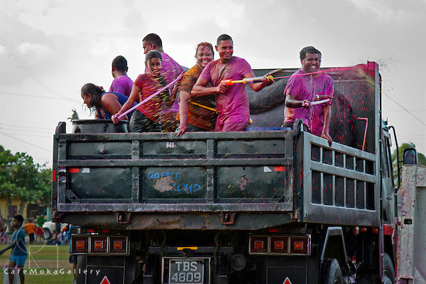 Phagwa or Holi - Truck with group of men and women squirting dye - Felicity