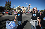 U.S. Senate candidate Catherine Cortez Masto supporters march in the annual Nevada Day parade in Carson City, Nev. on Saturday, Oct. 29, 2016. <br />