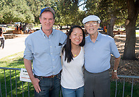 Grace Coogan '17 poses with her father, Tom , and grandfather, Jack. Students and parents enjoy the Occidental College campus during Homecoming on Oct. 24, 2014. (Photo by Marc Campos, Occidental College Photographer)
