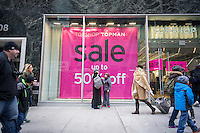 The Topshop/ Topman store on Fifth Avenue in Midtown Manhattan in New York advertises its Christmas sales on Sunday, December 21, 2014, the last weekend before the holiday. (© Richard B. Levine)