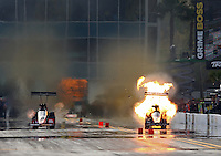 Mar 15, 2014; Gainesville, FL, USA; NHRA top fuel dragster driver Terry McMillen (right) explodes an engine alongside David Grubnic during qualifying for the Gatornationals at Gainesville Raceway Mandatory Credit: Mark J. Rebilas-USA TODAY Sports