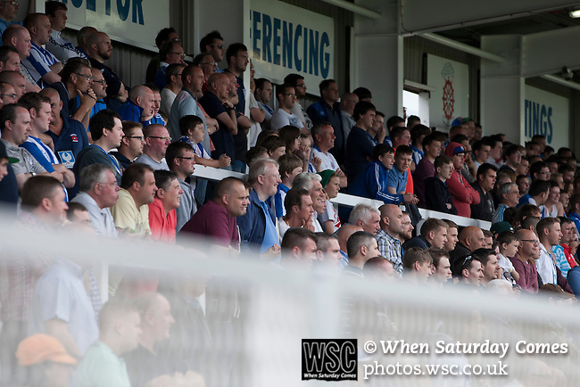Hartlepool United 0 Middlesbrough 0, 20/07/2013. Victoria Ground, Pre-Season Friendly. Supporters of Hartlepool United watching the first-half action at the Victoria Ground, Hartlepool, during a pre-season friendly between the home team and Middlesbrough. Hartlepool were relegated to League Two at the end of the 2012-13 season whilst their Teesside neighbours remained two divisions above them in the Championship. The game ended in a no-score draw watched by a crowd of 2307. Photo by Colin McPherson.