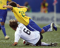 Michael Bradley wipes out Leandro Lima. USA stunned Brazil, winning 2-1 to finish first in their group. Final game in group D in Ottawa, Ontario, on JULY 6 2007.