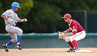 STANFORD, CA - April 23, 2011: Kenny Diekroeger of Stanford baseball awaits a pickoff from home during Stanford's game against UCLA at Sunken Diamond. Stanford won 5-4