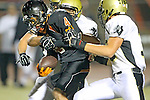 Beverly Hills, CA 09/23/11 - Frank Brown (Beverly Hills #4), Chris Whitehead (Peninsula #36) in action during the Peninsula-Beverly Hills Varsity football game.