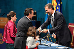 Prince Felipe of Spain gives to Spanish President of the ONCE Miguel Carballeda accompanied by his wife (R) the Prince of Asturias Award for Concord during the 2013 Prince of Asturias Awards ceremony at the Campoamor Theater in Oviedo, Spain. October 25, 2013..(ALTERPHOTOS/Victor Blanco)