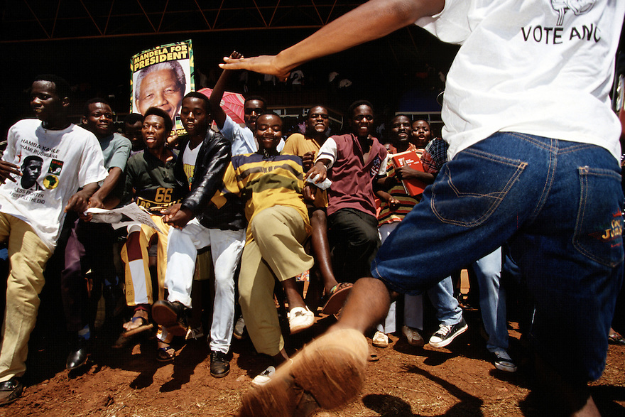 Crowds dance at a Nelson Mandela campaign event.  After more then 27 years in jail as an anti-apartheid activist,   Nelson Mandela lead a 1994 campaign for President as a member of the African National Congress (ANC),  in the first free elections in South Africa in 1994.  Mandela has received more than 250 awards over four decades, including the 1993 Nobel Peace Prize..