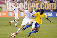 Michael Bradley (4) of the United States and Ramires (8) of Brazil batle for the ball. The men's national team of Brazil (BRA) defaeted the United States (USA) 2-0 during an international friendly at the New Meadowlands Stadium in East Rutherford, NJ, on August 10, 2010.