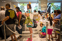 "Shoppers on line at the grand opening of the H&M Fifth Avenue department store in New York on Thursday, July 17, 2014. The store is the largest H&M with 57,000 square feet and to celebrate the opening Hennes & Mauritz has tied in with the artist Jeff Koons for a limited edition handbag with Koons' iconic ""Balloon Dog (Yellow)"" printed on it. Koons currently has a retrospective at the Whitney Museum as well as his ""split-Rocker"" on display a few blocks away in Rockefeller Center. While H&M has had numerous collaborations with designers, this is the first time they have worked with a major artist, albeit an artist that embraces the commercial aspects of fine art.    (© Richard B. Levine)"