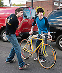 Brian McAllister shows Ian where to ride the bike down the street to the cafe.