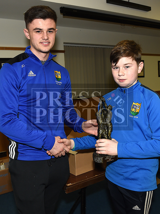 Tiernan Markey is presented with the under 12 Player of the Year award by Jonathan Commons at the St. Mary's juvenile awards night. Photo:Colin Bell/pressphotos.ie