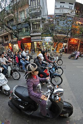 Asia, Vietnam, Hanoi. Hanoi old quarter. Motorbikes at a crossroad waiting to go.