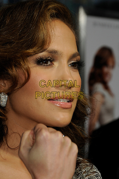 "JENNIFER LOPEZ .arriving at the premiere of CBS Films' ""The Back-up Plan"" at the Regency Village Theatre in Westwood, California, USA, April 21st, 2010..arrivals portrait headshot one shoulder silver earrings wavy hair hand profile .CAP/ROT.©Lee Roth/Capital Pictures"