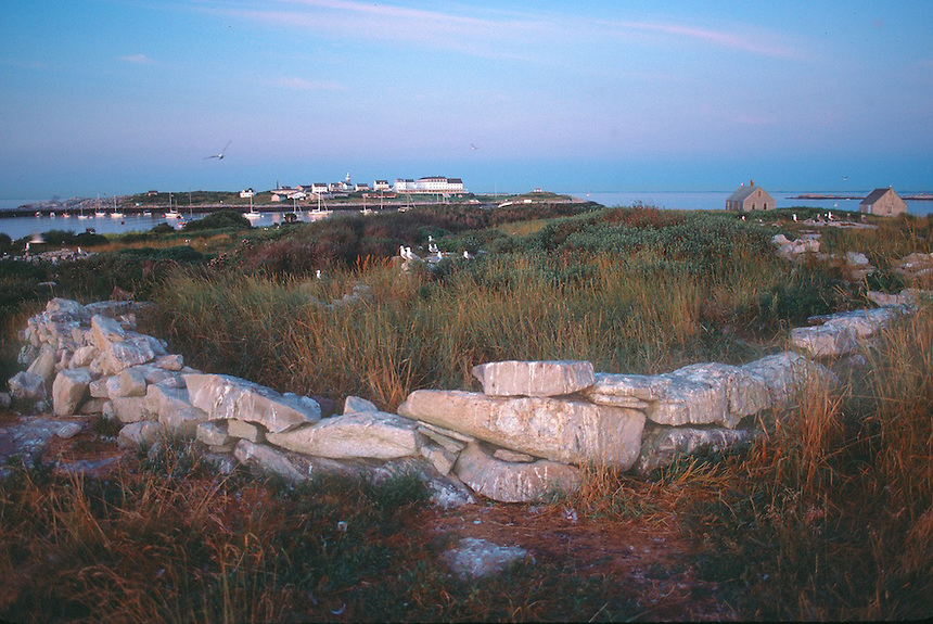 Ancient stone wall on Smuttynose island, Maine, Star Island in the background, Isles of Shoals, off the coast of New Hampshire. Photograph by Peter E. Randall.