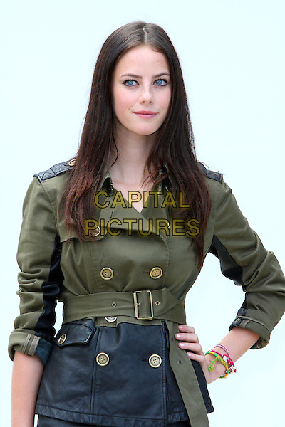 Kaya Scodelario.Burberry Prorsum S/S Show Arrivals at Kensington Gardens, London, England..September 19th 2011.LFW half length black leather jacket mac green hand on hip .CAP/ROS.©Steve Ross/Capital Pictures