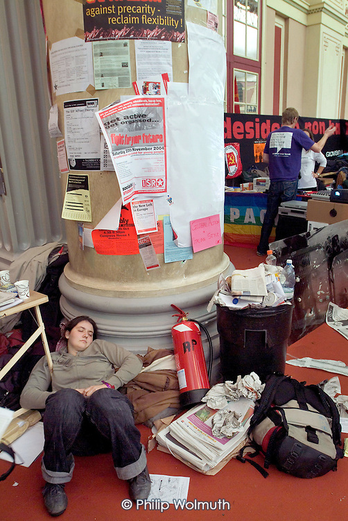 A young delegate sleeps at the back of a meeting hall at the European Social Forum in Alexandra Palace, London.
