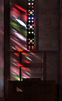 Stained glass by Marguerite Hure in the Eglise Saint-Joseph or St Joseph's Church, built 1951-58 as a memorial to the 5000 citizens of the town who died during the Second World War, designed by Auguste Perret, 1874-1954, and Raymond Audigier, Le Havre, Normandy, France. The church is built from pre-cast concrete, with geometric stained glass windows in vertical strips, a Neo-Gothic interior and a 107m tall tower which acts as a beacon from out at sea. Perret was mentor to Le Corbusier and specialised in the use of concrete. He led the reconstruction of Le Havre in the 1950s, after the town was completely destroyed in WWII. The centre of Le Havre is listed as a UNESCO World Heritage Site. Picture by Manuel Cohen