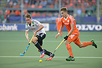 The Hague, Netherlands, June 06: Sander de Wijn #23 of The Netherlands runs with the ball during the field hockey group match (Men - Group B) between Germany and The Netherlands on June 6, 2014 during the World Cup 2014 at Kyocera Stadium in The Hague, Netherlands. Final score 0-1 (0-1) (Photo by Dirk Markgraf / www.265-images.com) *** Local caption *** Sander de Wijn #23 of The Netherlands, Oliver Korn #18 of Germany