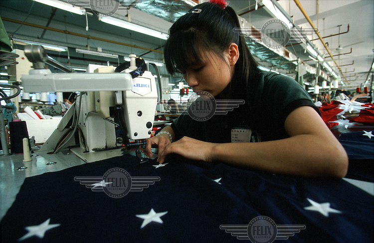 A female textile worker making Stars and Stripes styled T-shirts at the Wiseform Clothing factory.