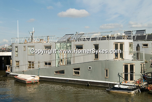 Nine Elms Wharf purpose bult boathouse. Floating home river Thames Battersea South London UK .