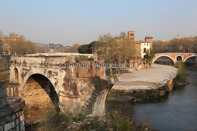 Ponte Emilio, called Ponte Rotto (Broken bridge), 2nd century BC, with Isola Tiberina (Tiber Island) in the background and Ponte Fabricio (Fabricius' Bridge), 1st century BC, in the distance, Rome, Italy. Picture by Manuel Cohen