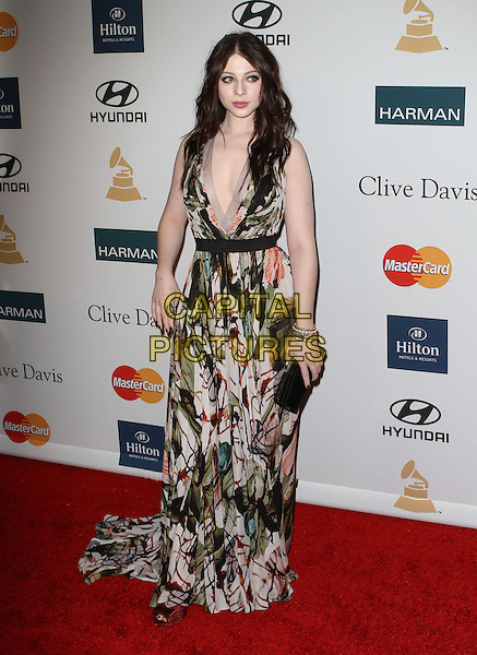 Michelle Trachtenberg.Clive Davis And The Recording Academy's 2012 Pre-GRAMMY Gala Held at Beverly Hilton Hotel, Beverly Hills, California, USA..February 11th, 2012.full length black white green dress print  clutch bag low cut neckline .CAP/ADM/KB.©Kevan Brooks/AdMedia/Capital Pictures.