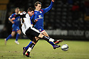 Kieron Freeman of Notts County and Luke Freeman of Stevenage stretch for the ball.  Notts County v Stevenage - npower League 1 - Meadow Lane, Nottingham - 22nd February, 2012. © Kevin Coleman 2012