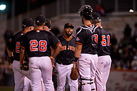 San Jose Giants relief pitcher Joey Marciano (54) is welcomed to the mound by the infielders and manager Bill Hayes (51) during a California League game against the Visalia Rawhide on April 12, 2019 at San Jose Municipal Stadium in San Jose, California. Visalia defeated San Jose 6-2. (Zachary Lucy/Four Seam Images)