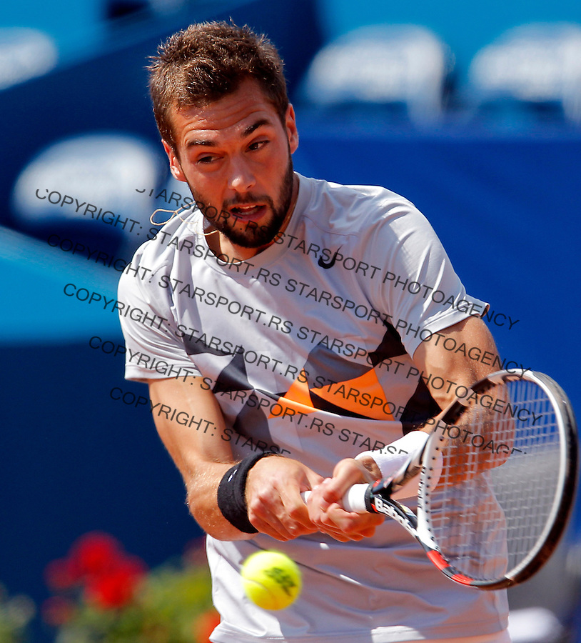 French tennis player Benoit Paire, returns the ball to Spanish Pablo Andujar during their ATP 250 Serbia Open semifinal match in Belgrade, Serbia, 5 May 2012. (credit: Pedja Milosavljevic/SIPA PRESS)