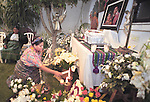 1992 Nobel peace prize winner Rigoberta Menchu Tum, a Mayan Indian woman from war-torn Guatemala lights candles at an altar during a burial ceremony for her youngest son, who lived only 3 days after a difficult pregnancy.