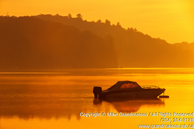 boat on Raven Lake at dawn; sunrise; recreation; cottage country<br />