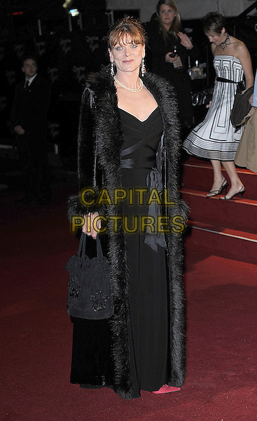 "SAMANTHA BOND.The Royal World Premiere of ""Quantum Of Solace"" at the Odeon Leicester Square, London, England. .October 29th 2008 .James Bond full length jacket fur trim coat jacket dress.CAP/BEL.©Tom Belcher/Capital Pictures."