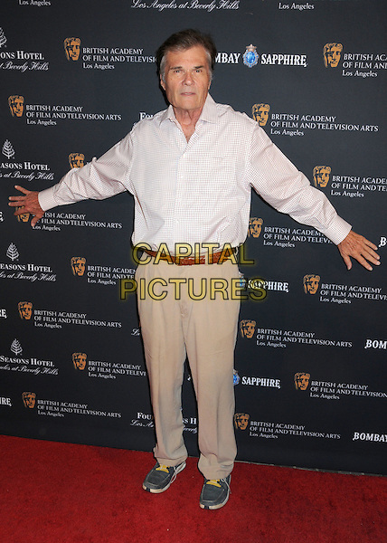 FRED WILLARD .17th Annual BAFTA Los Angeles Awards Season Tea Party held at the Four Seasons Hotel, Beverly Hills, California, USA, 15th January 2011..full length white shirt hands arms beige trousers brown belt trainers  checked .CAP/ADM/BP.©Byron Purvis/AdMedia/Capital Pictures.