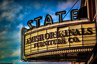 State theater in uptown Westerville with Amish Originals Furniture Company lettering on marquee.