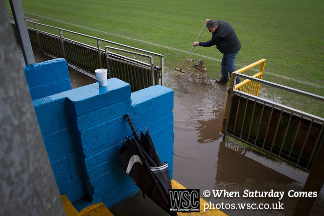 Port Talbot Town 3 Caerau Ely 0, 06/02/2016. Genquip Stadium, Welsh Cup fourth round. A groundsman sweeping away surface water from the pitch surround before Port Talbot Town played host to Caerau Ely in a Welsh Cup fourth round tie at the Genquip Stadium, formerly known as Victoria Road. Formed by exiled Scots in 1901 as Port Talbot Athletic, they competed in local and regional football before being promoted to the League of Wales  in 2000 and changing their name to the current version a year later. Town won this tie 3-0 against their opponents from the Welsh League, one level below the welsh Premier League where Port Talbot competed, watched by a crowd of 113. Photo by Colin McPherson.
