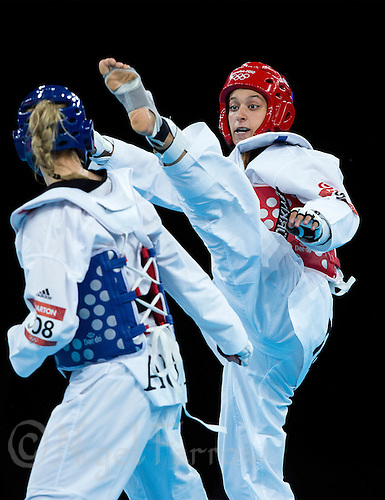 10 AUG 2012 - LONDON, GBR - Nur Tatar (TUR) (right) of Turkey aims a kick at Carmen Marton of Australia during their women's -67kg category semi final contest at the London 2012 Olympic Games Taekwondo at Excel in London, Great Britain .(PHOTO (C) 2012 NIGEL FARROW)