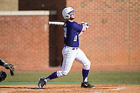 Spencer Angelis (11) of the High Point Panthers follows through on his swing against the UNCG Spartans at Willard Stadium on February 14, 2015 in High Point, North Carolina.  The Panthers defeated the Spartans 12-2.  (Brian Westerholt/Four Seam Images)
