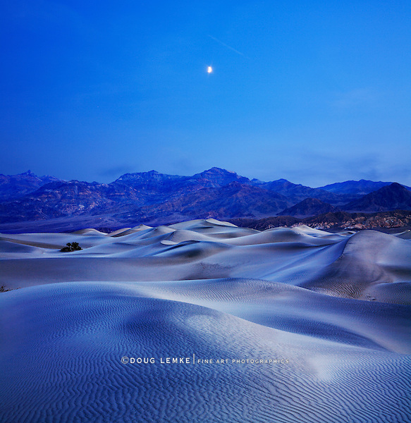 Sand Dunes, Mountains And Moonrise In The Predawn Light At Stovepipe Wells, Death Valley National Park, California, USA