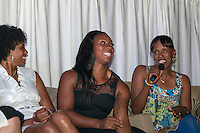 Connie Teaberry and Gwen Berry react to what Jackie Joyner-Kersee says during the panel disucssion at the Brittany Borman Foundation Olympic Celebration in Festus, MO. Friday, September 13, 2013.
