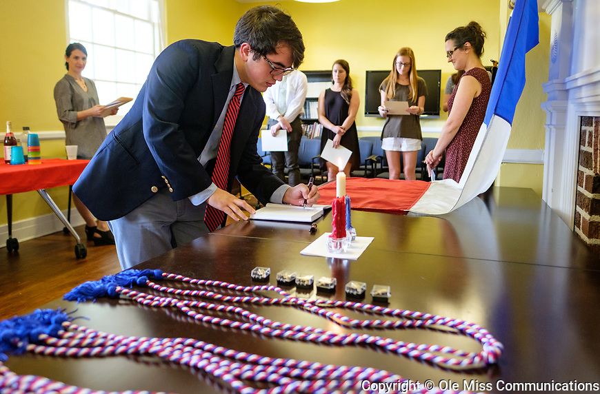 Each Pi Delta Phi inductee signs the registry and then receives their pin and certificate and if applicable, also a sash. Photo by Robert Jordan/Ole Miss Communications