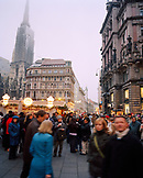 AUSTRIA, Vienna, Grabren Street, crowd of people celebrating Christmas with St. Stephen's Cathedral in the background